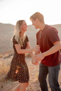 excited couple having fun in desert in summer